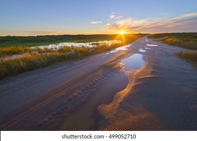 Sandy road in the sunset, Sakhalin Island, Russia.