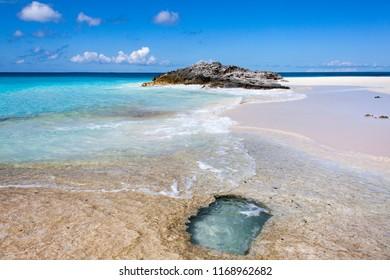 The sandy and rocky beach on uninhabited Half Moon Cay island (Bahamas).