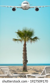 sandy sea coast with white sunbed and palm leaves and white airliner, template concept resort holiday, vertical photo