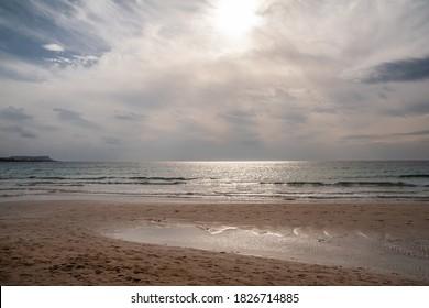 Sandy seashore against the sky