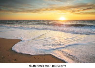 Sandy seashore at sunset. Nature landscape.