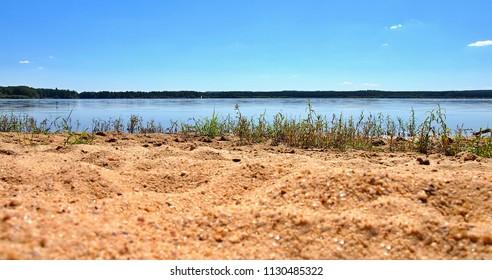 Sandy shore of beautiful Dvoriste pond near Trebon city in South Bohemia, Czech Republic.