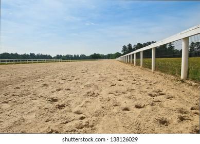 A sandy southern horse race track.