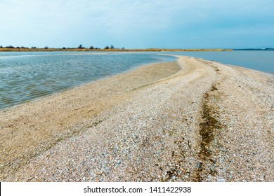 The sandy spit leading in the sea with the ground covered with shell. Russia, Azov sea, Taganrog bay, Beglitsk Spit.