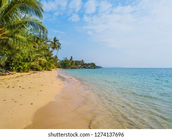 Sandy Thai beach, transparent azure sea and a romantic cottage among palm trees finally a beautiful blue sky as long as the eye can see.