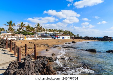 Sandy tropical beach in Puerto del Carmen seaside town, Lanzarote, Canary Islands, Spain