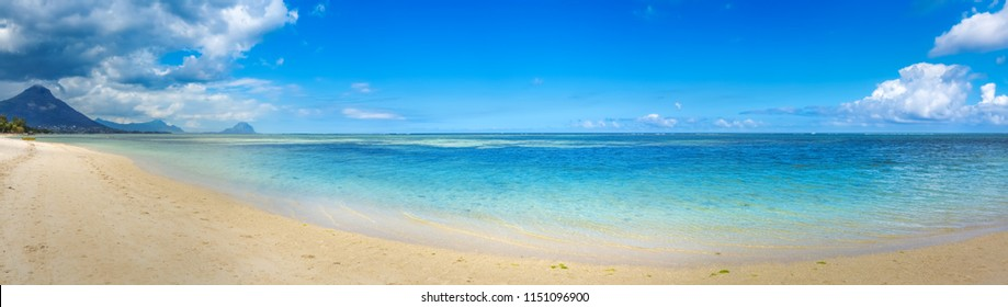 Sandy tropical Wolmar beach at sunny day. Beautiful landscape. Panorama. Mauritius