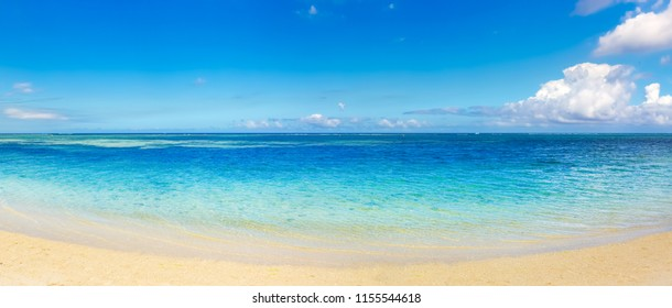 Sandy tropical Wolmar beach at sunny day. Beautiful landscape. Panorama. Mauritius