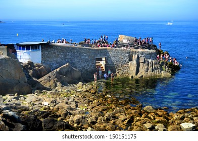 SANDYCOVE, IRELAND - CIRCA JULY: Swimmers at Sandycove's famous 'Forty Foot' circa July 2013 in Sandycove, Ireland. The Forty Foot features in the novel 'At Swim-Two-Birds' by Flann O'Brien (1939).