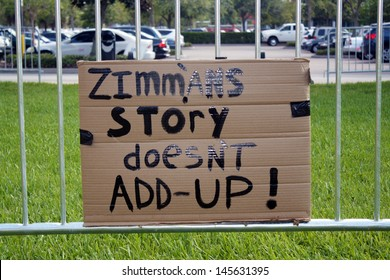 SANFORD, FL - JULY 9, 2013: A cardboard protest sign hangs on the fence outside the Zimmerman murder trial at the Seminole County Criminal Justice Center in Sanford, Florida, on July 9, 2013.