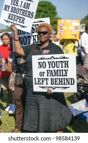 SANFORD, FL-MACRH 26:  A female protester holds a sign in support of Trayvon Martin on March 26, 2012 in Sanford Florida.