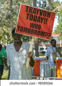 SANFORD, FL-MARCH 26: A protester holds a signs in support of Trayvon Martin. March 26, 2012 in Sanford Florida. Trayvon Martin was shot and killed by George Zimmerman on February 26 2012, he was 17.