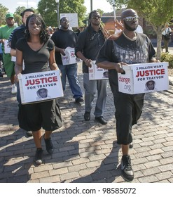 SANFORD, FL-MARCH 26: Protesters march  in support of Trayvon Martin on March 26, 2012 in Sanford Florida. Trayvon Martin was shot and killed by George Zimmerman on February 26 2012, he was 17.