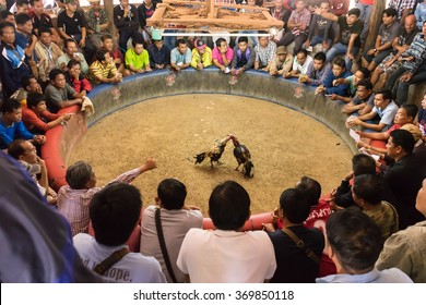 Sang Khom, Thailand - January 31, 2016: Asian people bet their money in small arenas at illegal competion of cockfighting