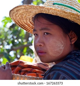 SANGHAR, MYANMAR - JANUARY 15: Pa-O tribe girl Lihn Moe, age 13, with Thanaka paste on the face poses for a photo during Htamanu Festival on January 15, 2011 in Sanghar Village, Shan state, Myanmar