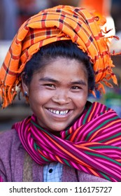 SANGHAR, MYANMAR - JANUARY 15: An unidentified smiling Pa-O tribe woman posing for the photo during the local Htamanu Festival on January 15, 2011 in Sanghar Village, Shan state, Myanmar