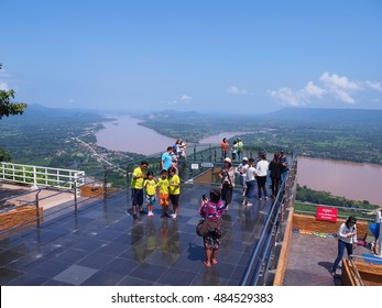 SANGKHOM DISTRICT, NONG KHAI, THAILAND - SEPTEMBER 17, 2016: People travel to see a beautiful view on the sky walker at Wat Pa Tak Suer, Sangkhom District, Nong Khai Province, Thailand