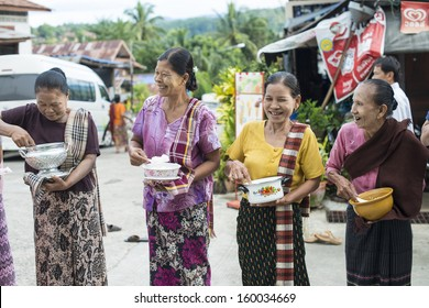 SANGKLABURI - OCT 18 : Thai people waiting to donate food to the monks in Sankaburi,Thailand on October 18, 2013. Sanklaburi is popular town for the tourism in Thailand.