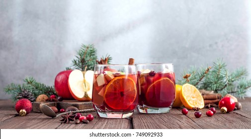 Sangria with Apple, cranberry and orange for Christmas table