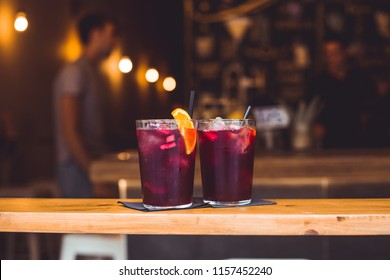 Sangria with Fruit in a Glasses Old Wooden Background in the Bar in Barcelona, Spain