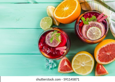 Sangria and ingredients in glasses, copy space