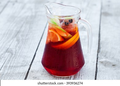 sangria with red wine in a jug on the boards