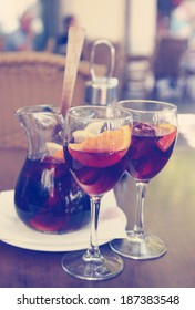 Sangria in two glasses on a table in cafe, instagram effect