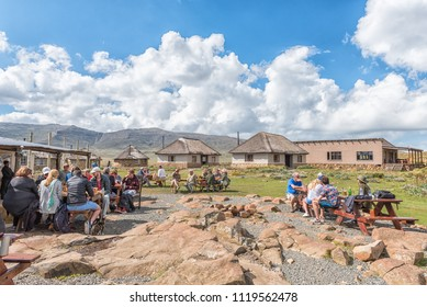 SANI TOP, LESOTHO - MARCH 24, 2018: Unidentified tourists at the Sani Mountain Lodge at the top of the Sani Pass. The lodge claims the the title of highest pub in Africa