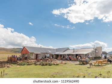 SANI TOP, LESOTHO - MARCH 24, 2018: Unidentified tourists at the Sani Top Mountain Lodge at the top of the Sani Pass. The lodge claims the the title of highest pub in Africa