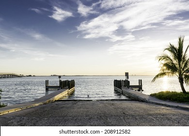 Sanibel Island Boat Ramp At Sunrise With Palm Tree