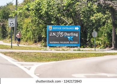 Sanibel Island, USA - April 29, 2018: JN Ding Darling national wildlife refuge park by beach and road in Fort Myers, Florida sign entrance