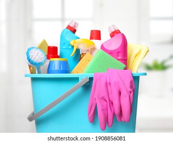 Sanitary bottles,desinfectants in plastic bucket.Housework supplies.Domestic chemical items.