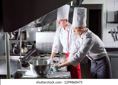 Sanitary day in the restaurant. Repeats wash your workplace. Cooks wash oven, stove and extractor in the Restaurant