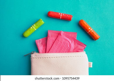 sanitary pads and tampons in handbag