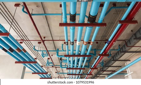 Sanitary pipe system installation on ceiling.