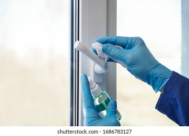 sanitizer disinfection of handles on windows and doors in rooms