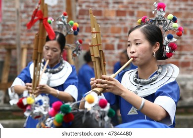 SANJIANG - November 12: Dong ethnic minority people perform during the yearly Dong Lusheng festival on 12 November 2010 in Sanjiang, China.