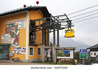 SANKT GILGEN, AUSTRIA - FEBRUARY 25, 2016: Valley station of the Zwoelferhorn aerial tram during a snowfall in alpine village Sankt Gilgen, Austria.