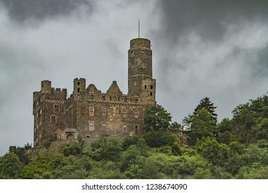 Sankt Goar, Germany - 7/15/2013:  Burg Maus Castle along the Rhine river near Sankt Goar, Germany,