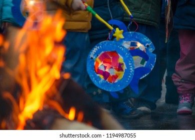sankt martin day, bonfire and children with lantern, defocused