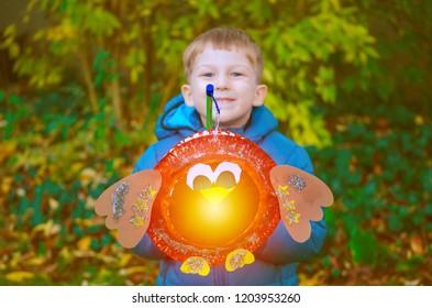 sankt martin day, a boy defocused with lantern, soft focus