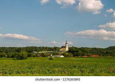 Sankt Martin an der Raab. Saint Martin by the Raab. Panorama of the church and cemetery on the hill. Rural landscape with church. Lower Austria. Burgenland. Central Europe.