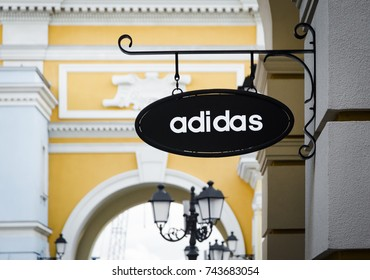 Sankt - Petersburg, Russia - 20 october 2017: A sign for an Adidas retail store. Adidas Is a Germanl corporation that designs and manufactures clothing and accessories for sports and fitness