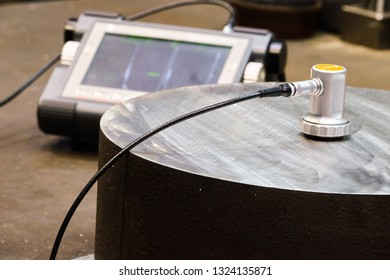 Sankt Petersburg, Russia - February 15, 2019: Ultrasonic flaw detector krautkramer USM 36 at the plant during accurate measurement of steel thickness at a machine-building plant. precision instrument