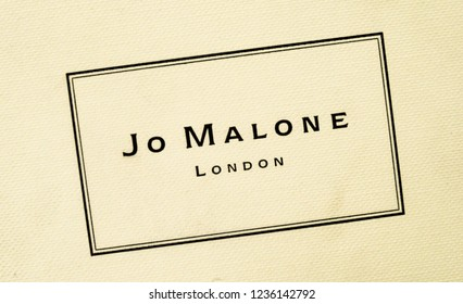 Sankt Petersburg, Russia - November 17, 2018: Jo Malone London logo on the branded gift box. Jo Malone London is a British perfume and scented candle brand, owned since 1999 by Estée Lauder