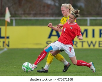 SANKT POELTEN, AUSTRIA - APRIL 13, 2015: Josefine Rybrink (#2 Sweden) and Laura Wienroither (#4 Austria) fight for the ball during a UEFA women's U17 qualifying game.
