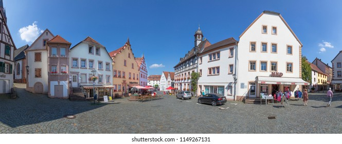 SANKT WENDEL, GERMANY - AUG 3, 2018: famous historic Schlossplatz (castle ground)  in Sankt Wendel with panoramic view of historic half timbered houses.