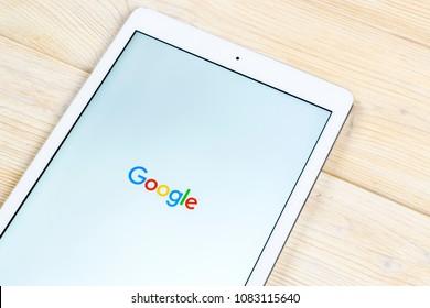 Sankt-Petersburg, Russia, April 1, 2018: Google application icon on Apple iPad smartphone screen close-up. Google app icon. Social network. Social media icon