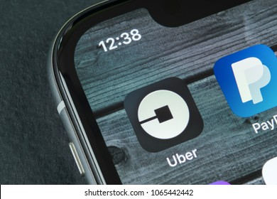 Sankt-Petersburg, Russia, April 10, 2018: Uber application icon on Apple iPhone X screen close-up. Uber app icon. Uber is taxi car transportation application.