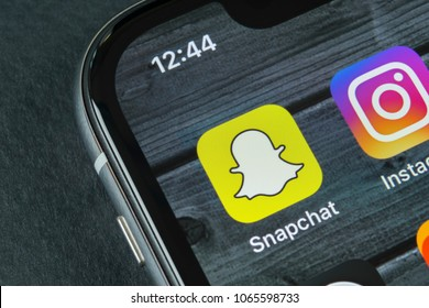 Sankt-Petersburg, Russia, April 10, 2018: Snapchat application icon on Apple iPhone X smartphone screen close-up. Snapchat app icon. Social media icon. Social network